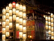Photo of Gion Festival Night Parade with lit up lanterns in Kyoto